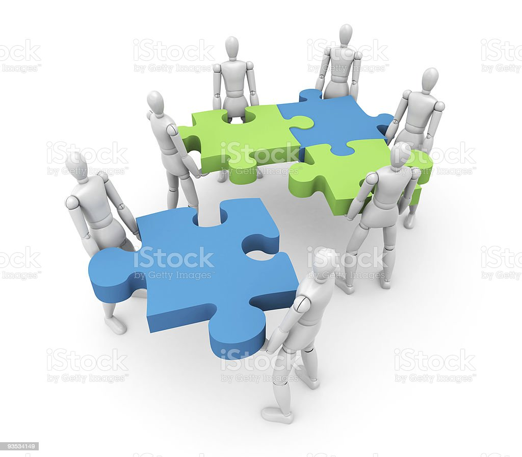 Play figures holding puzzle pieces to show teamwork on white royalty-free stock photo