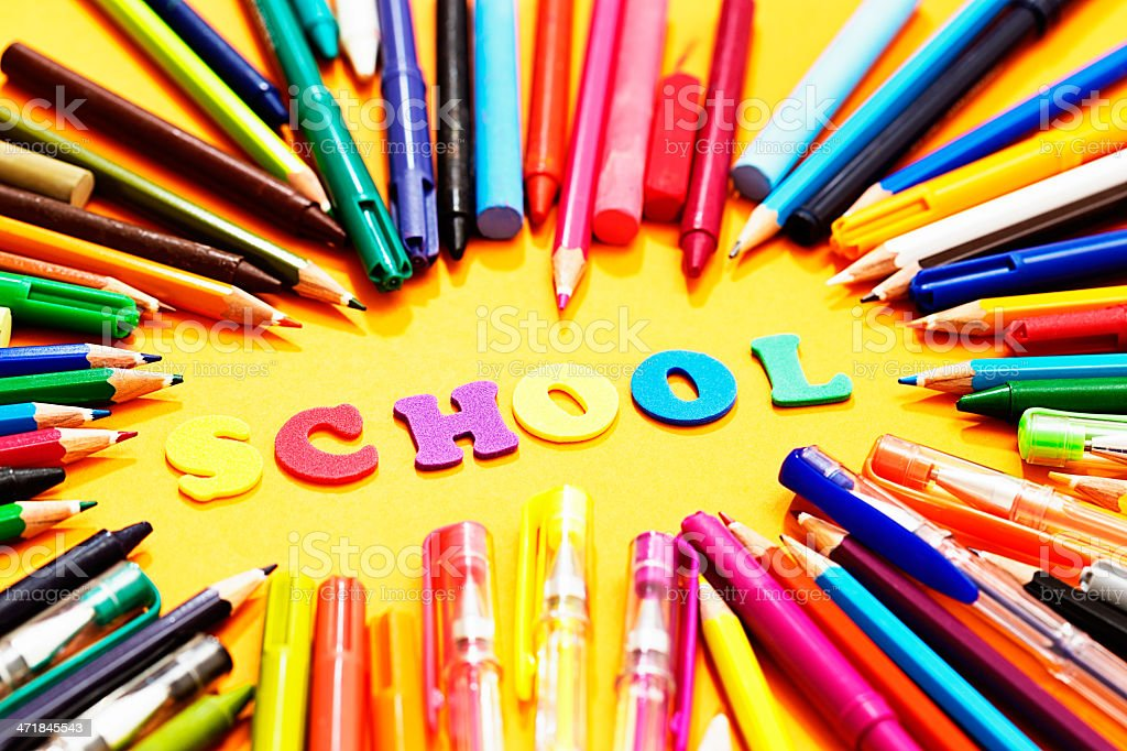 Play letters with drawing materials say SCHOOL; looks like fun! royalty-free stock photo