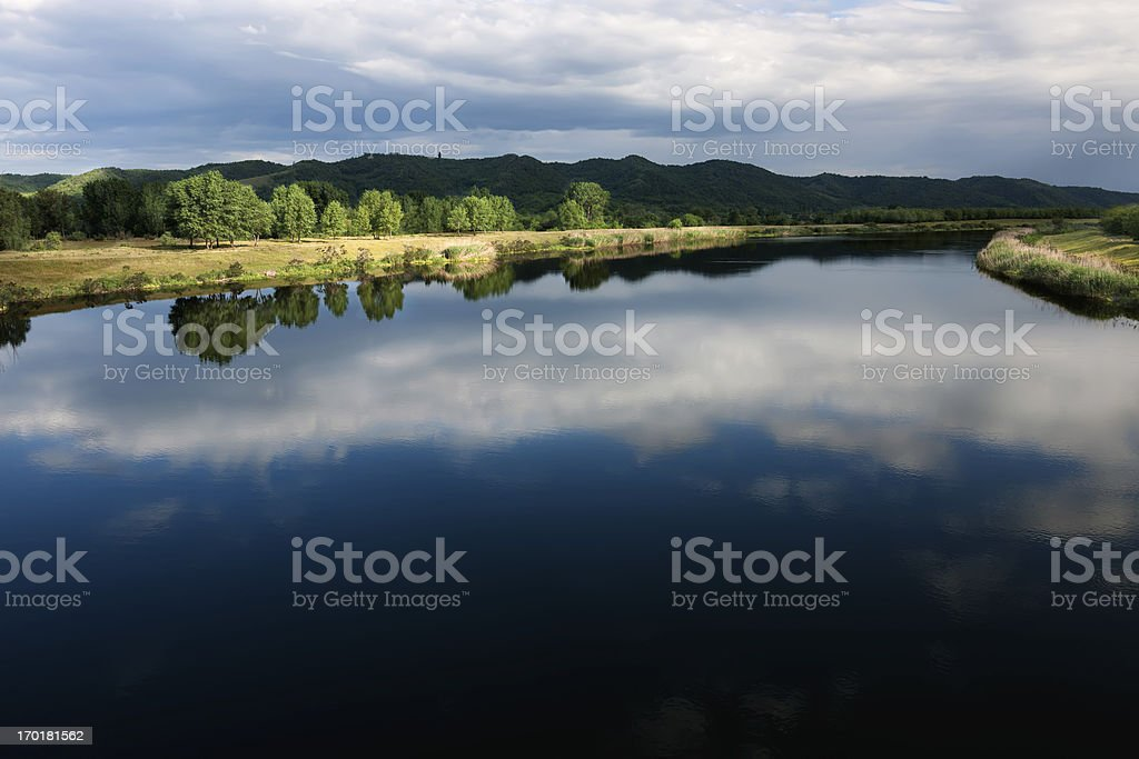 Play of light and shadow on a beautiful river landscape. stock photo