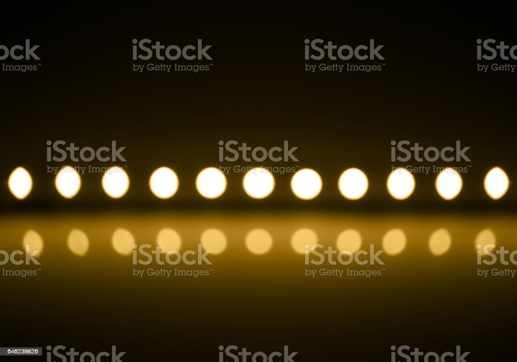 Play of yellow light on defocusing blur led lamps background stock photo