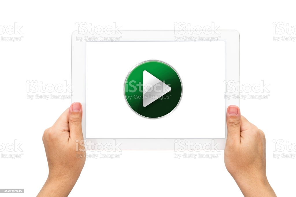 Play on Green Button with holding tablet stock photo