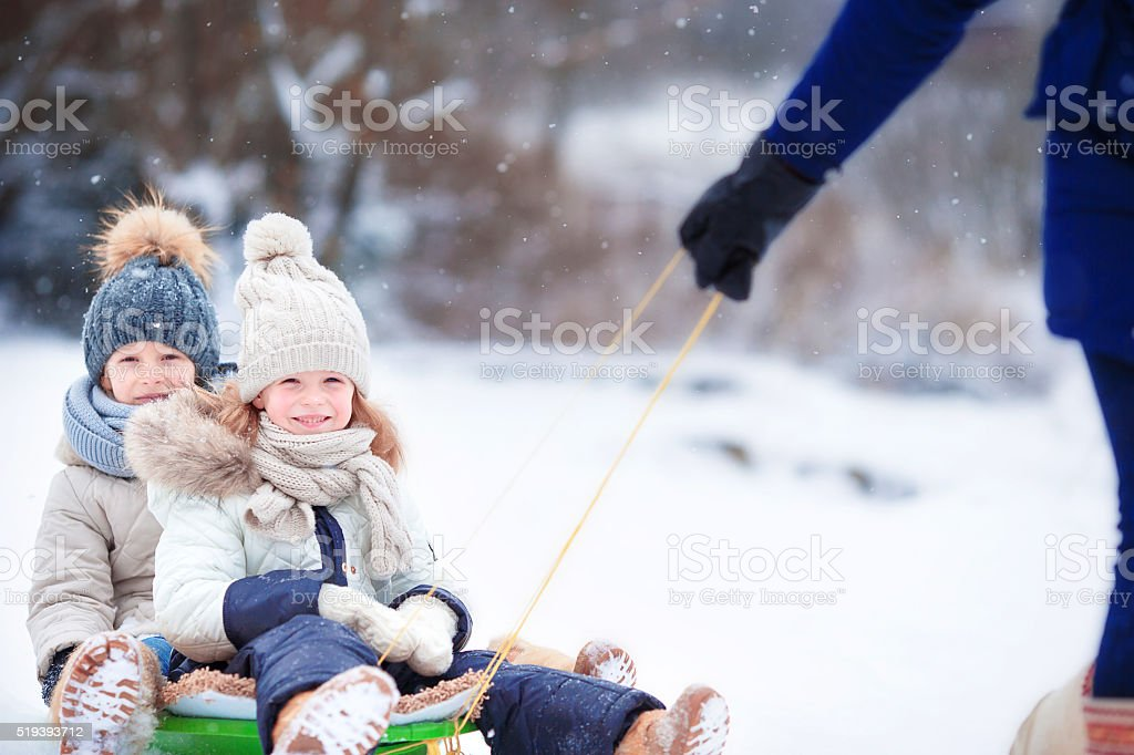 play outdoors in snow. Family vacation stock photo