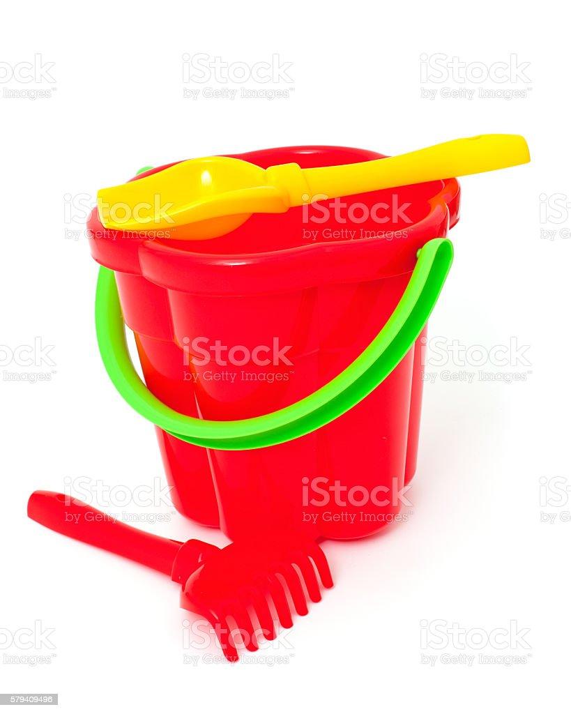 play set with bucket, shovel and rake on white stock photo