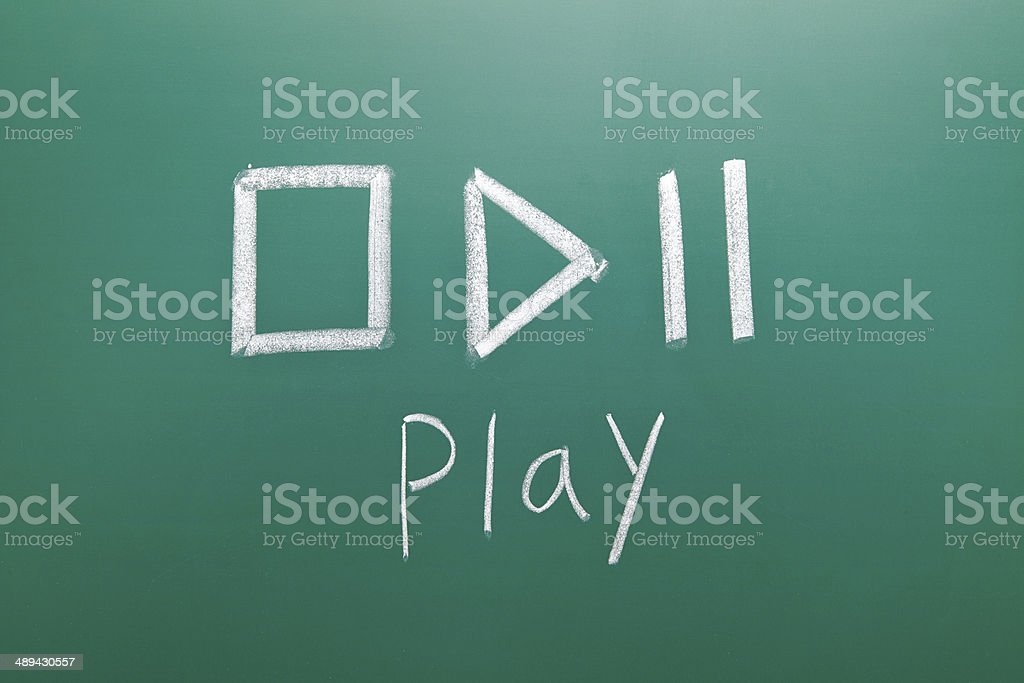 play sign drawn with chalk on blackboard stock photo
