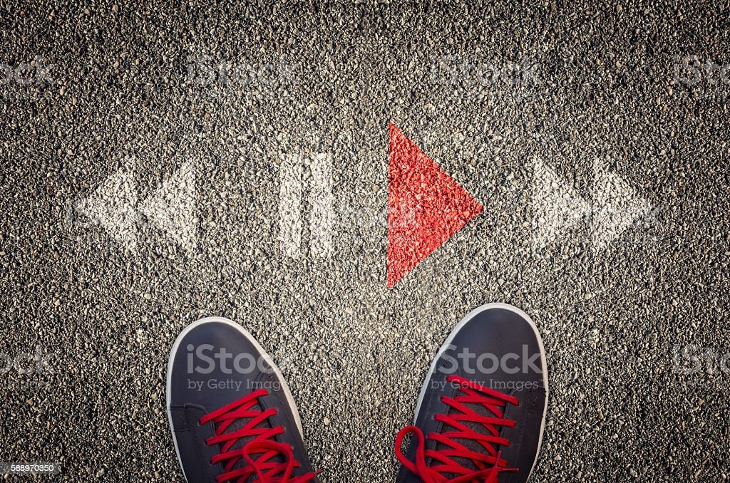 Play stop and rewind icons on asphalt stock photo