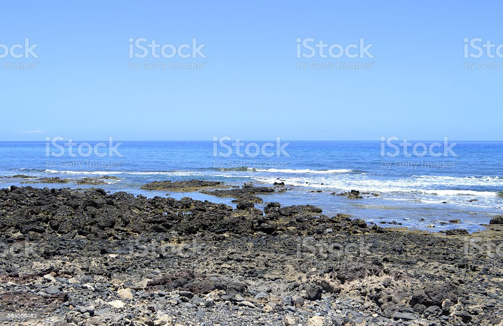Playa De Las Americas beach volcanic rock in Tenerife stock photo