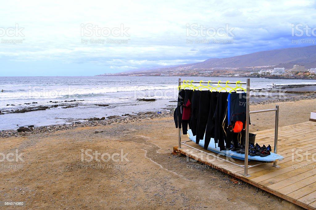 Playa De Las Americas surfing wetsuits on the beach stock photo