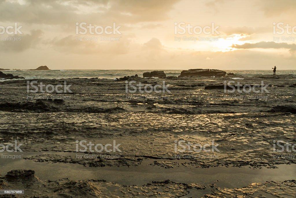 Playa Pelada Fisherman at Sunset stock photo