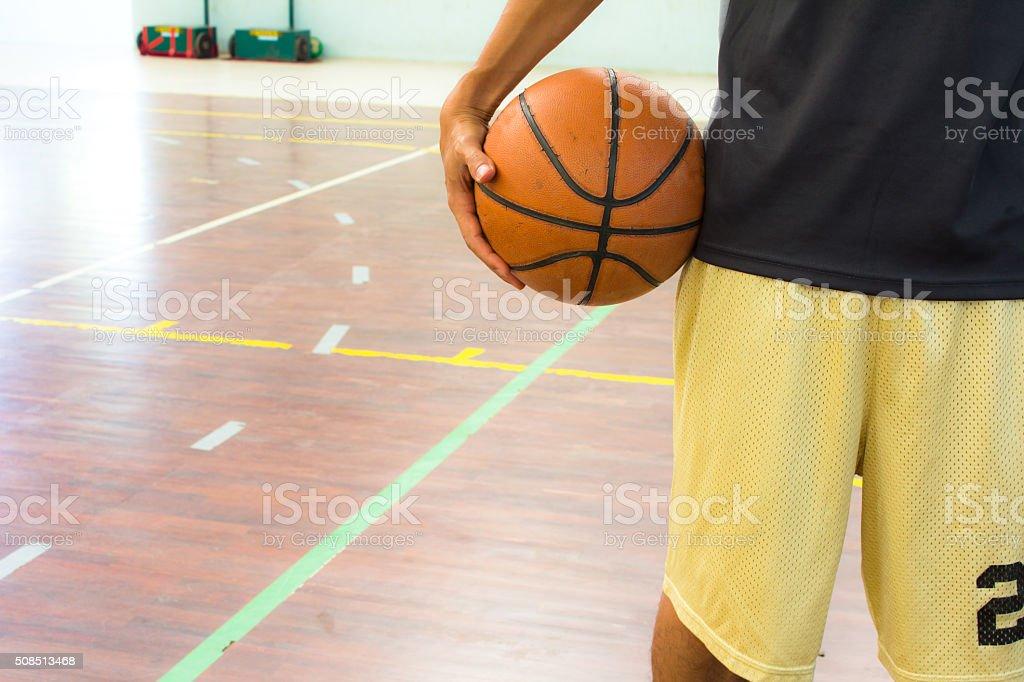 Playeer with basketball ball stock photo