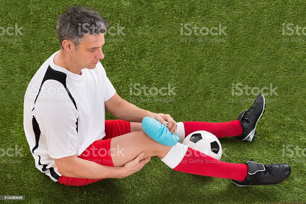 Player Icing Knee With Ice Pack stock photo