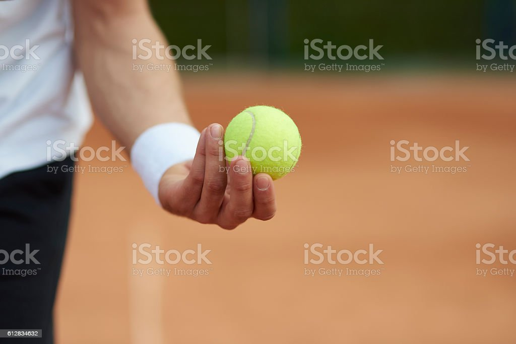 Player is holding a tennis ball stock photo