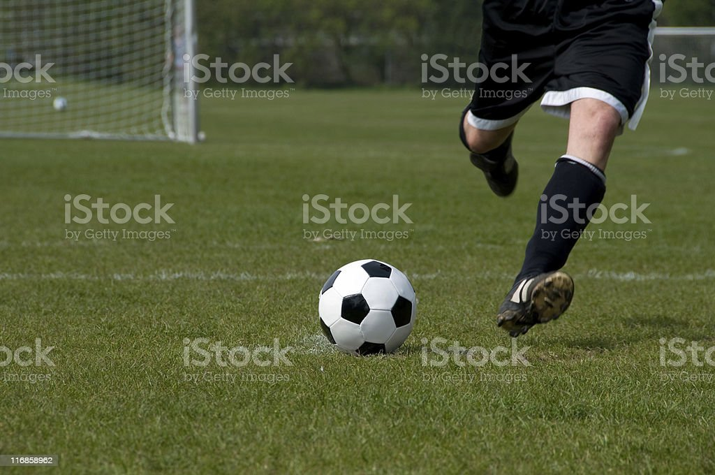 Player kicks the ball at a penalty shoot out royalty-free stock photo