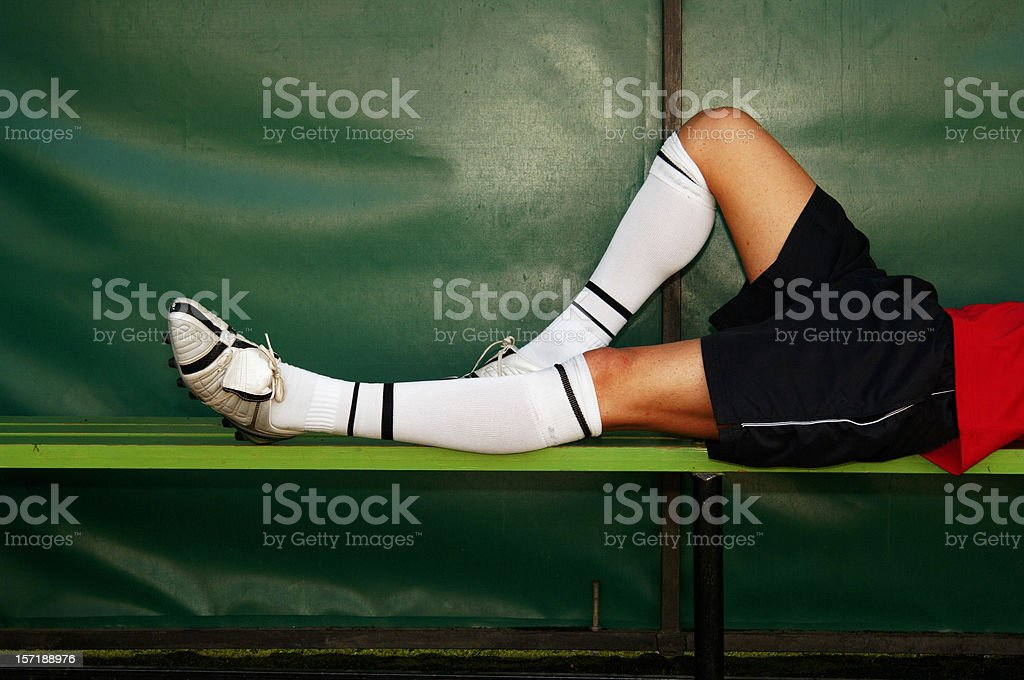 Player of football resting in the bench stock photo