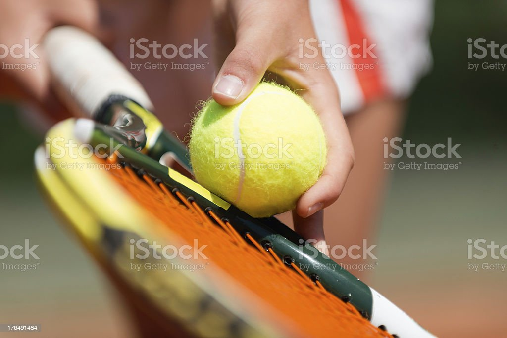 A player preparing to serve in a tennis match stock photo