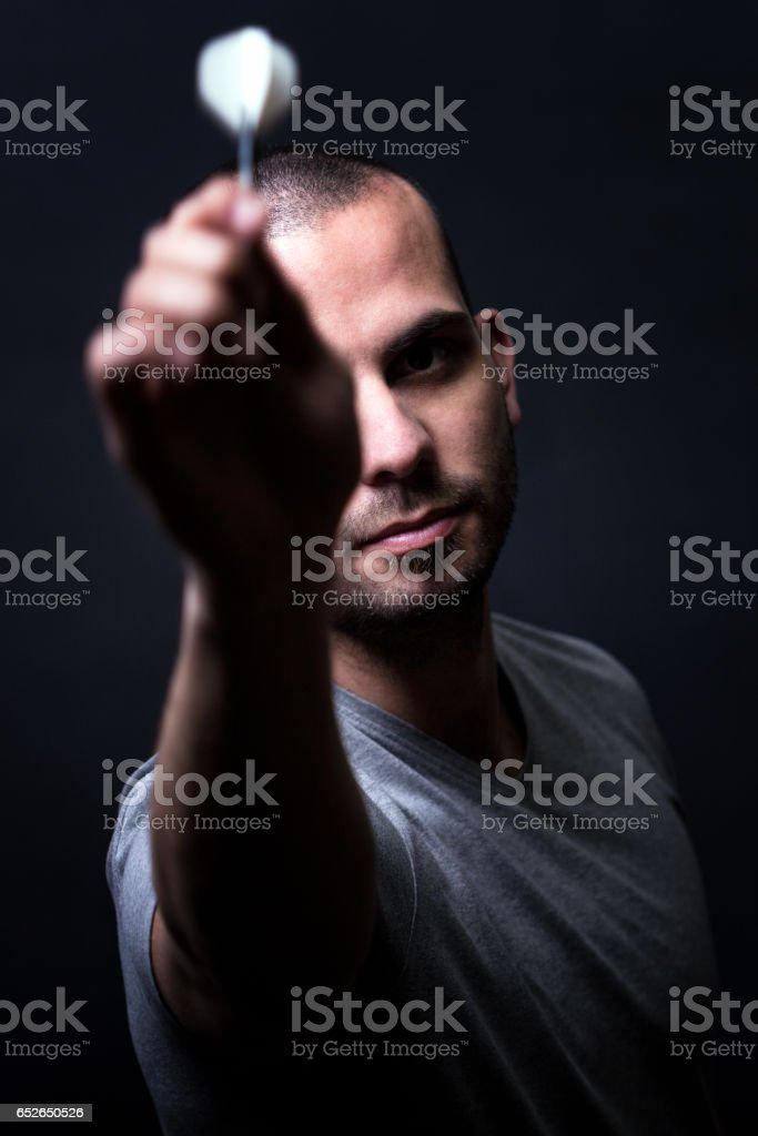 Player shooting darts stock photo