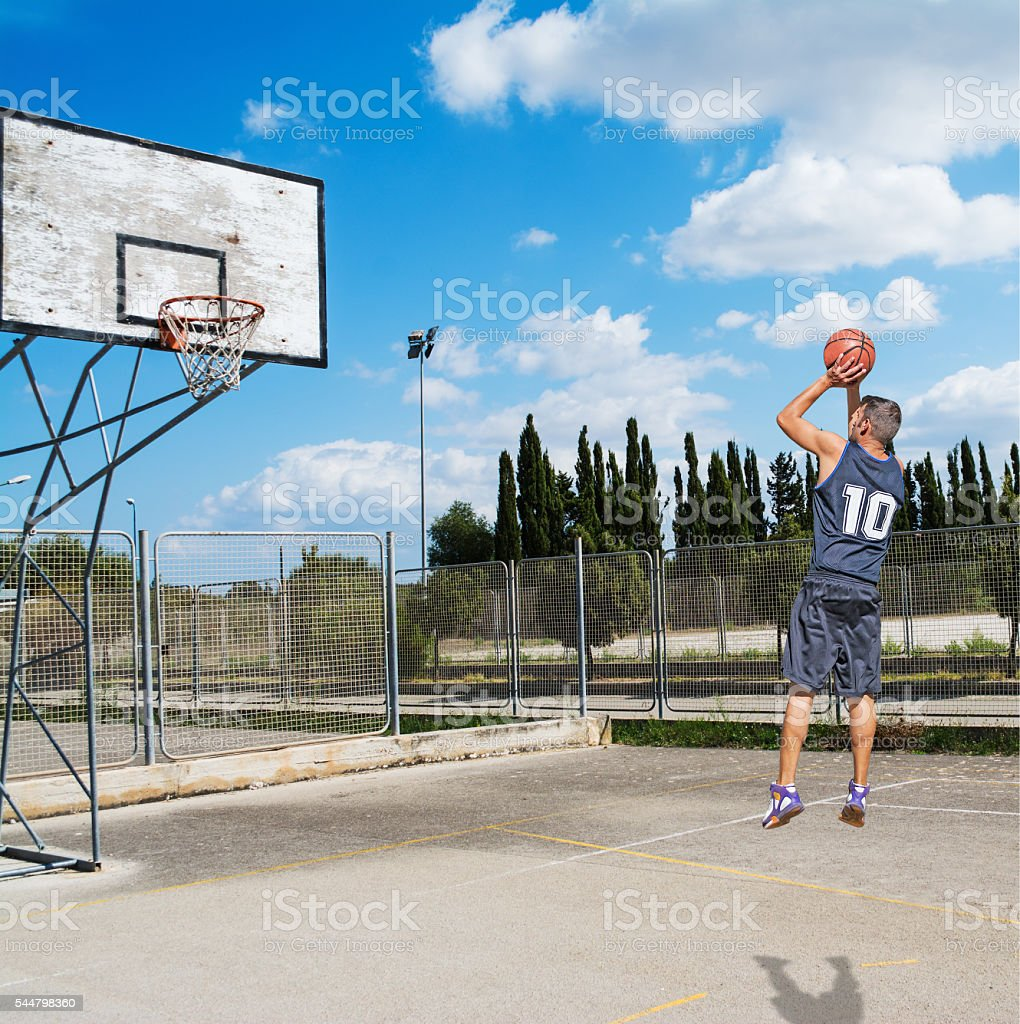 player shooting in a playground stock photo