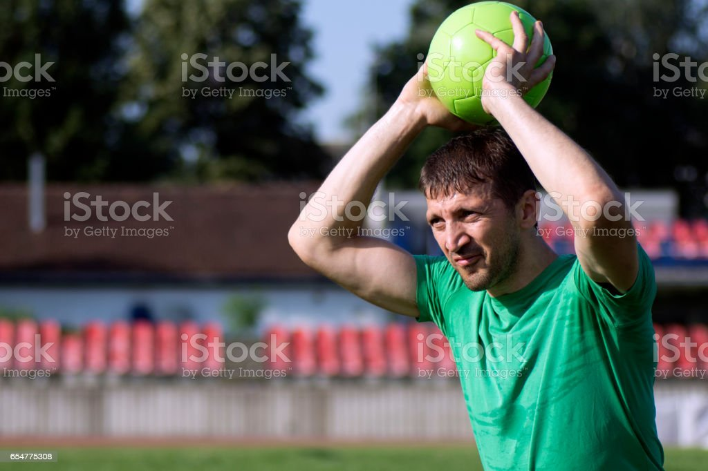 player throws ball stock photo