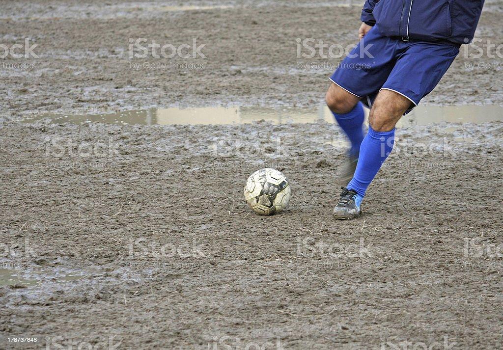 player who takes the ball during a football match stock photo