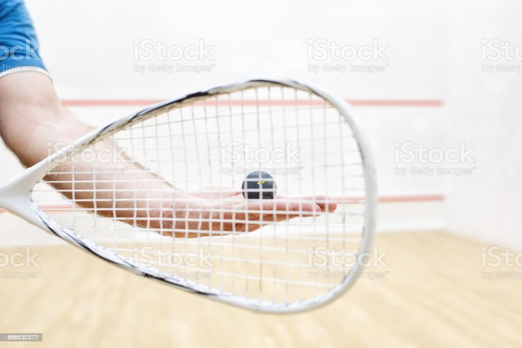 player with squash ball and racket stock photo