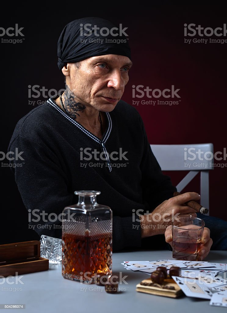 player with whiskey and cigar stock photo