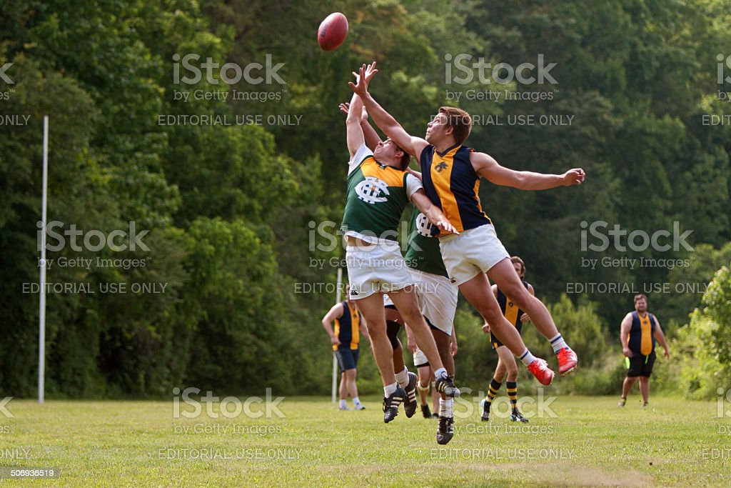 Players Jump For Ball In Australian Rules Football Game stock photo