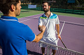 Players shake hands before and after the tennis match.