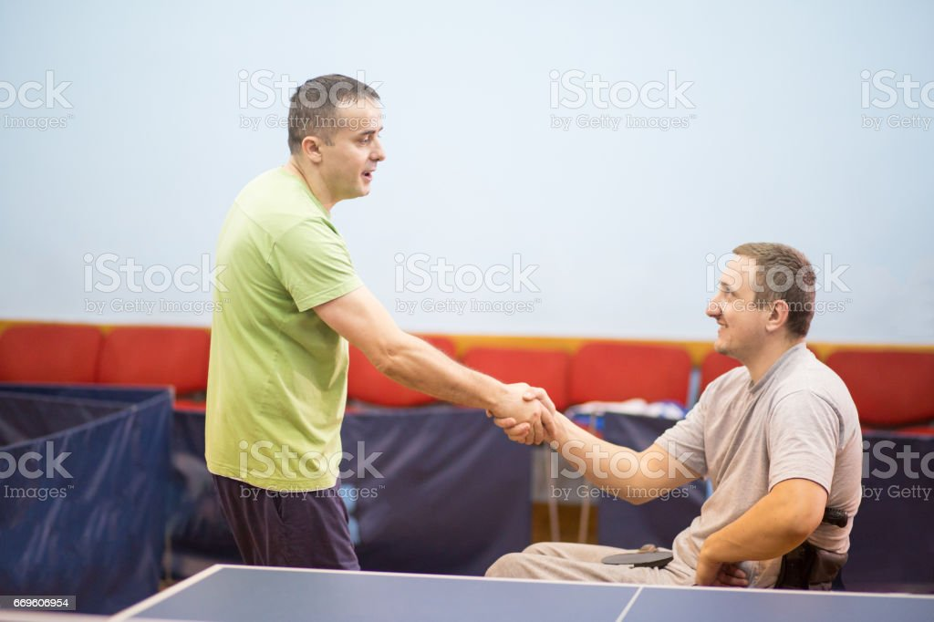 players shaking hands after match stock photo