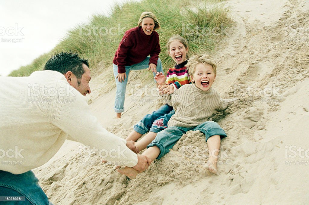 Playfighting on the sand dunes stock photo