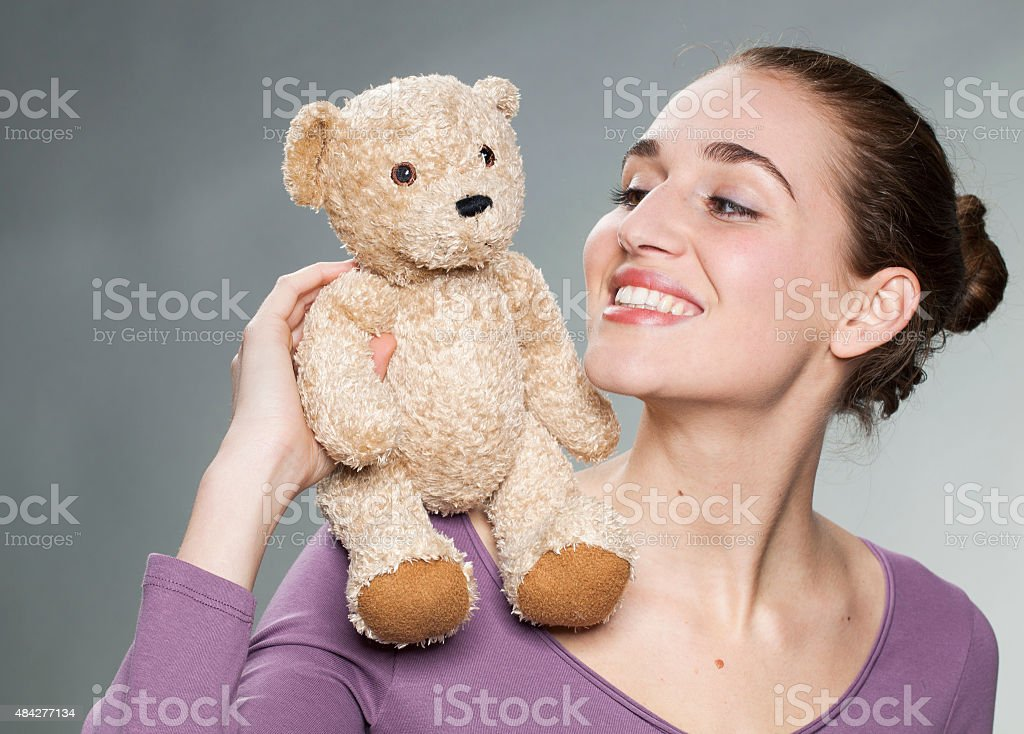 playful 20s girl holding her favorite comforter with emotion stock photo