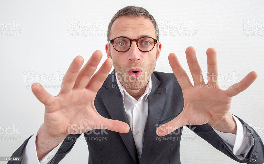 playful 40s manager grabbing or touching with hands in foreground stock photo