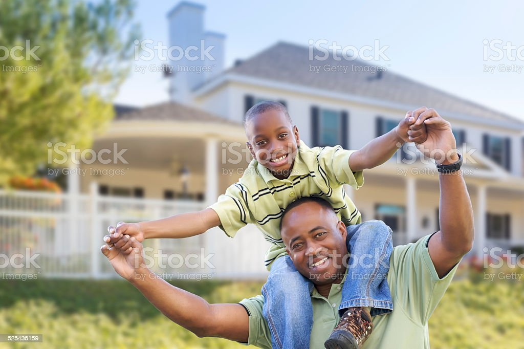 Playful African American Father and Son In Front of Home stock photo