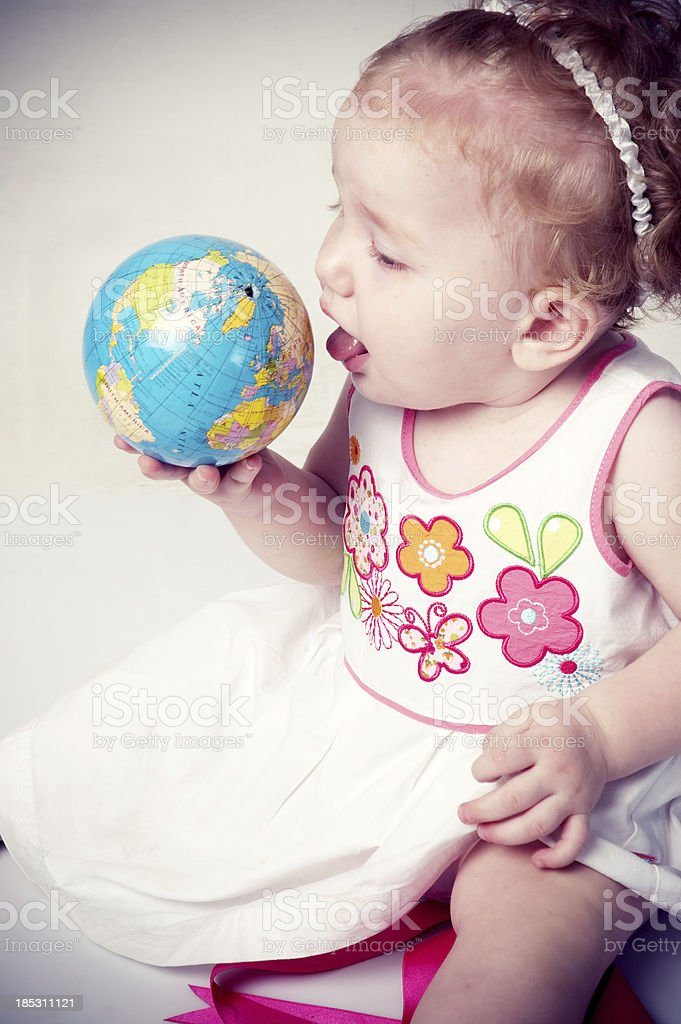 playful baby playing with the globe royalty-free stock photo