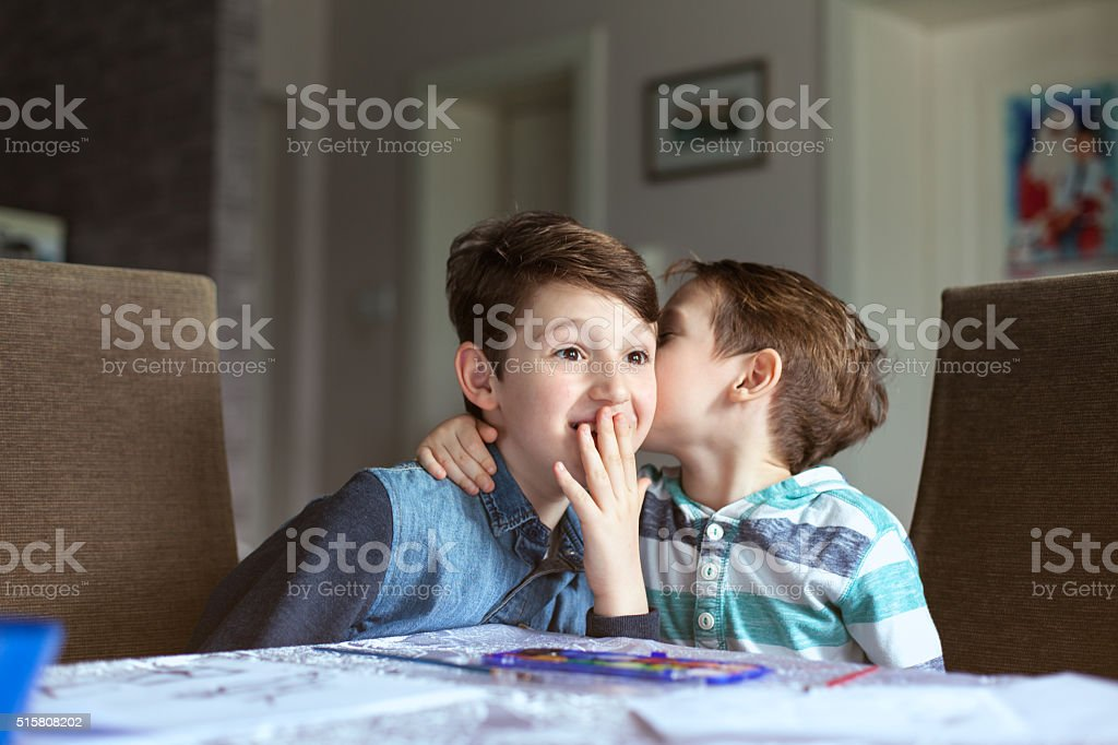 Playful brothers painting together. stock photo