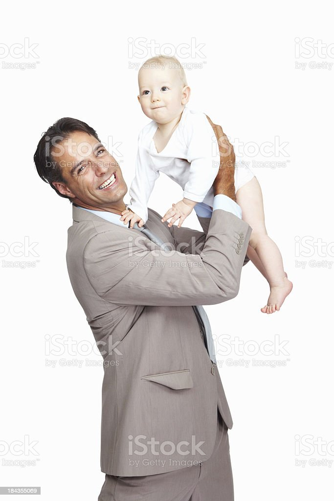 Playful business man with his baby royalty-free stock photo