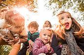 Playful children in autumn.