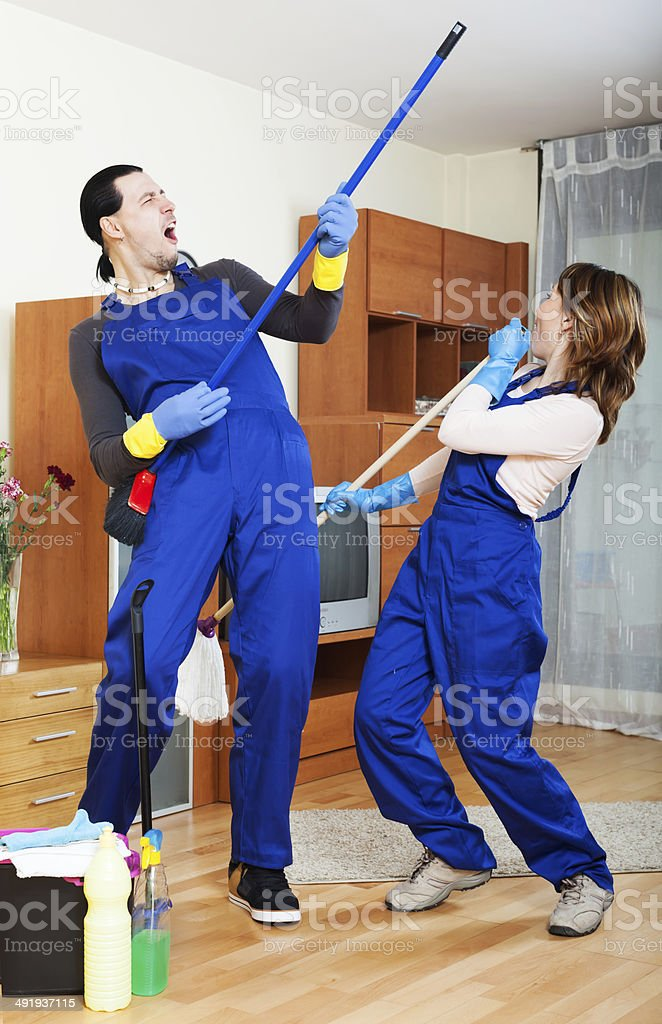 Playful cleaning premises team stock photo