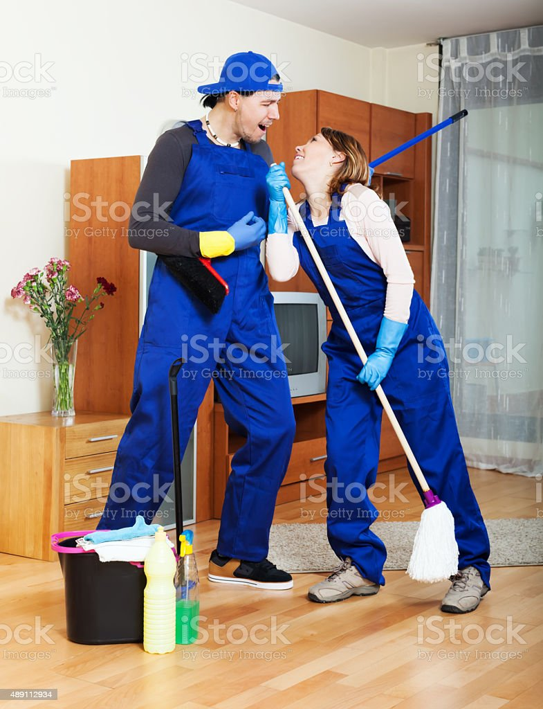 Playful cleaning team stock photo