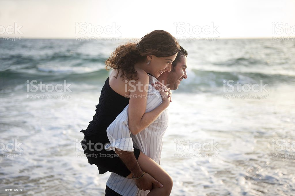 Playful couple at the beach royalty-free stock photo