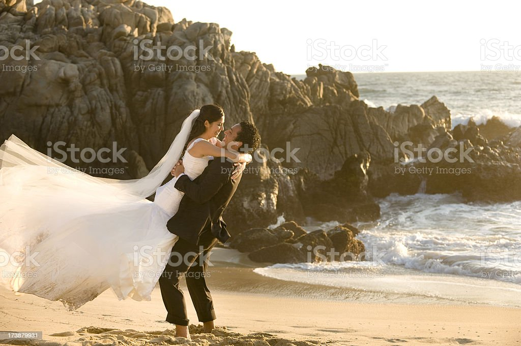 Playful couple by the beach royalty-free stock photo