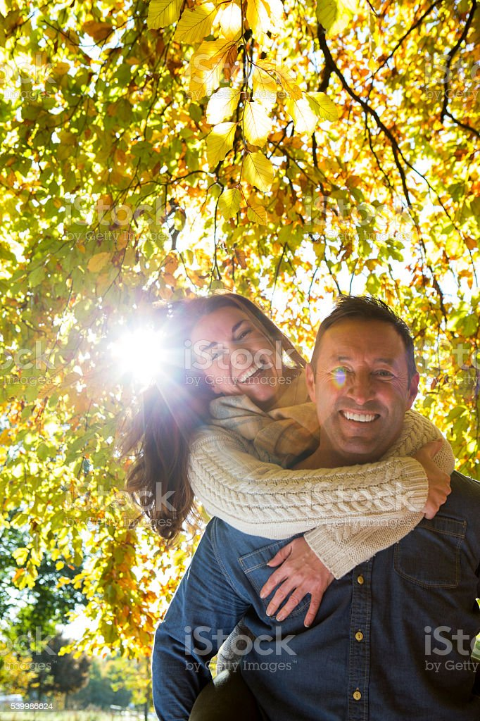 Playful Couple in Autumn stock photo