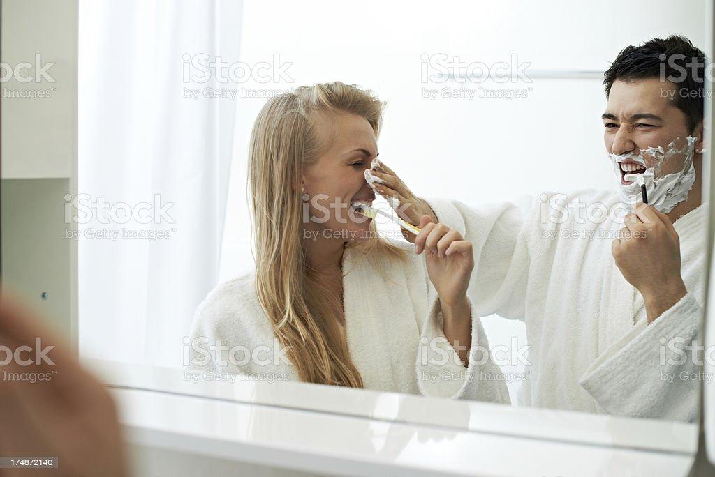 Playful couple in bathroom stock photo