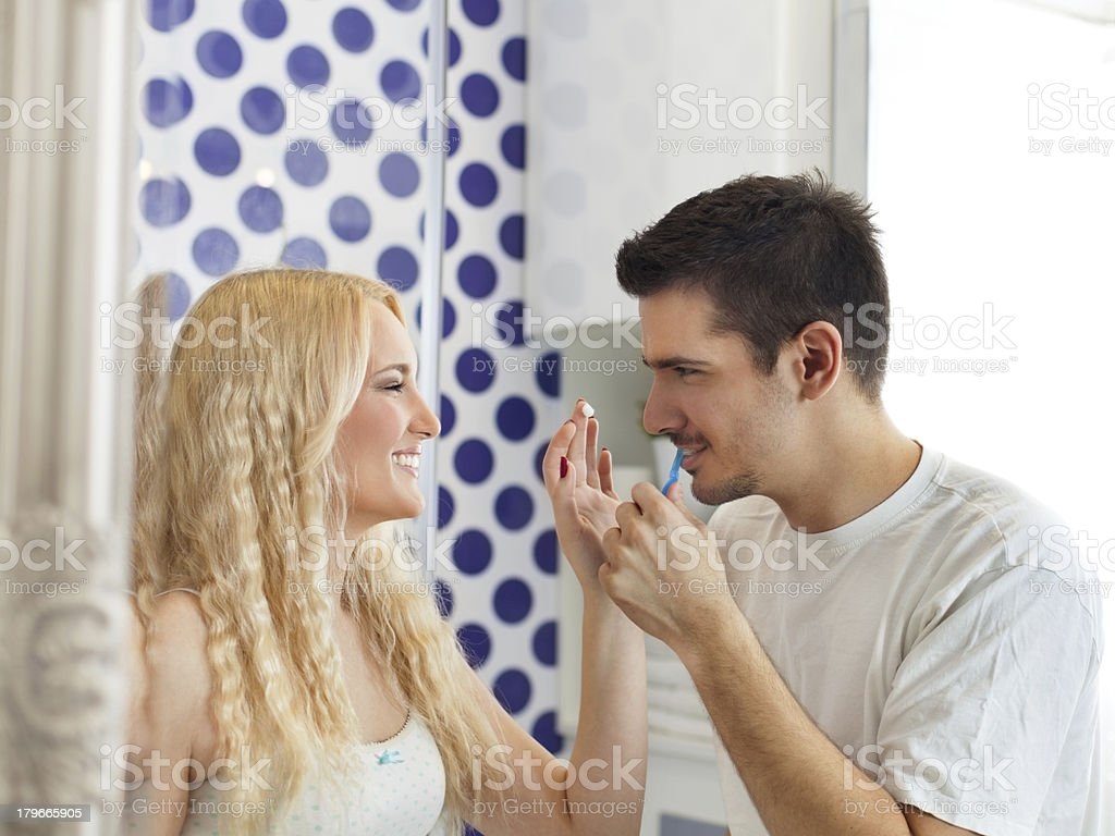 Playful couple in the bathroom royalty-free stock photo