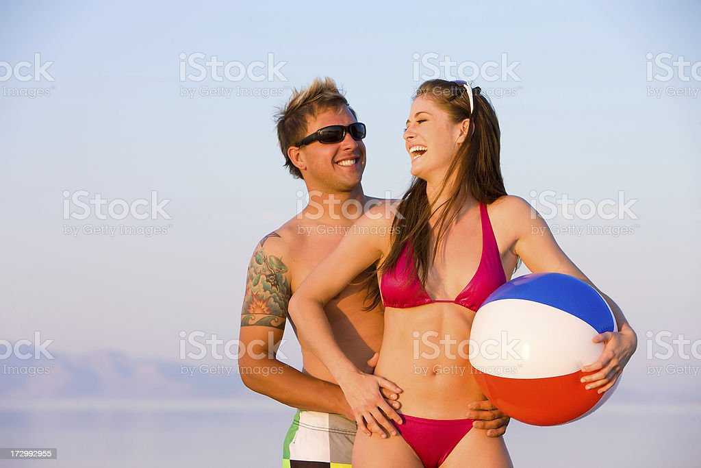 Playful Couple Laughing at Beach royalty-free stock photo