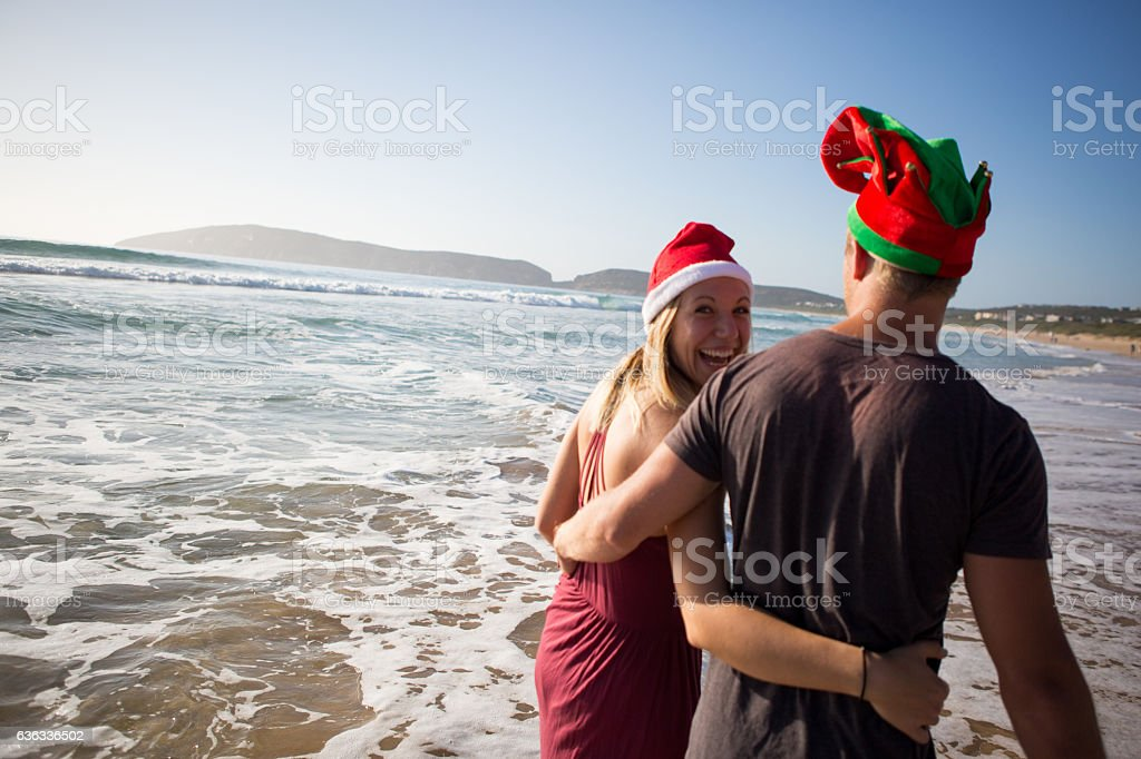 Playful couple on a summer Christmas holiday! stock photo