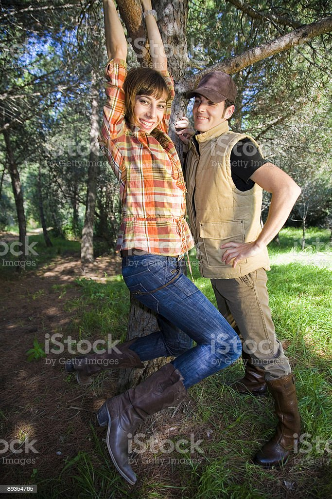 Playful couple on the forest royalty-free stock photo