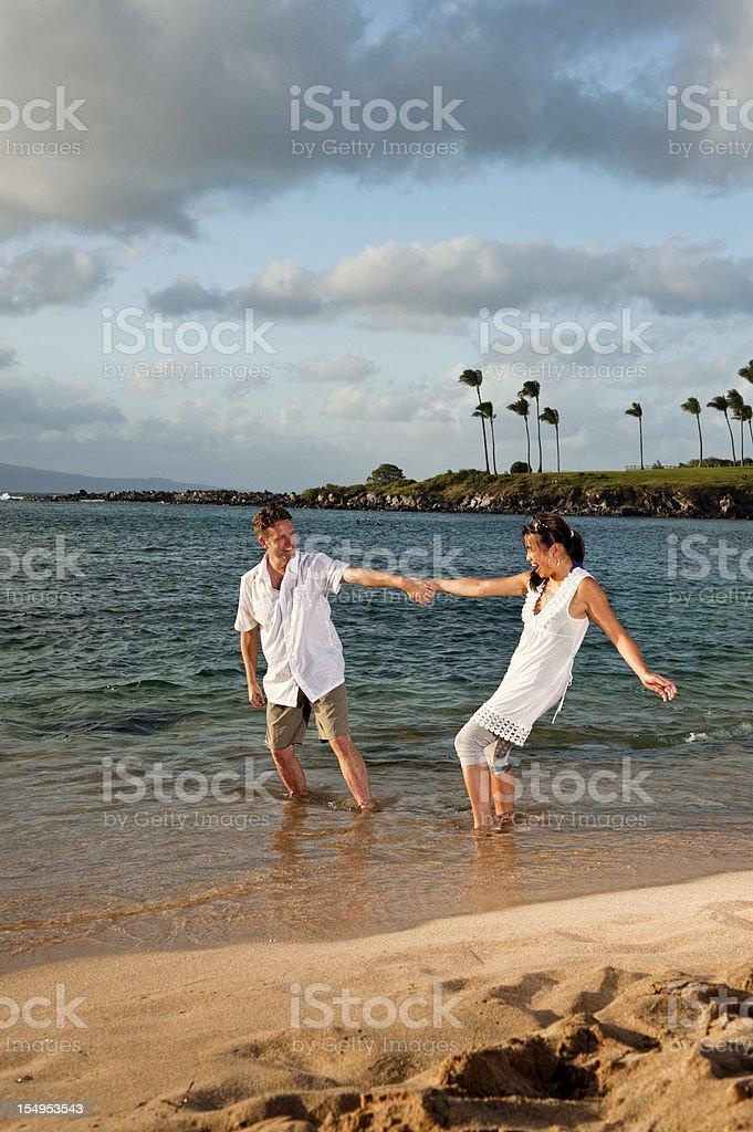 Playful Couple on Tropical Beach stock photo