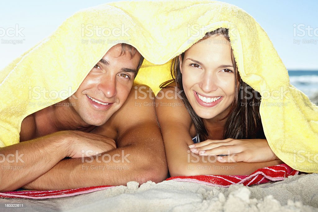 Playful couple under towel royalty-free stock photo
