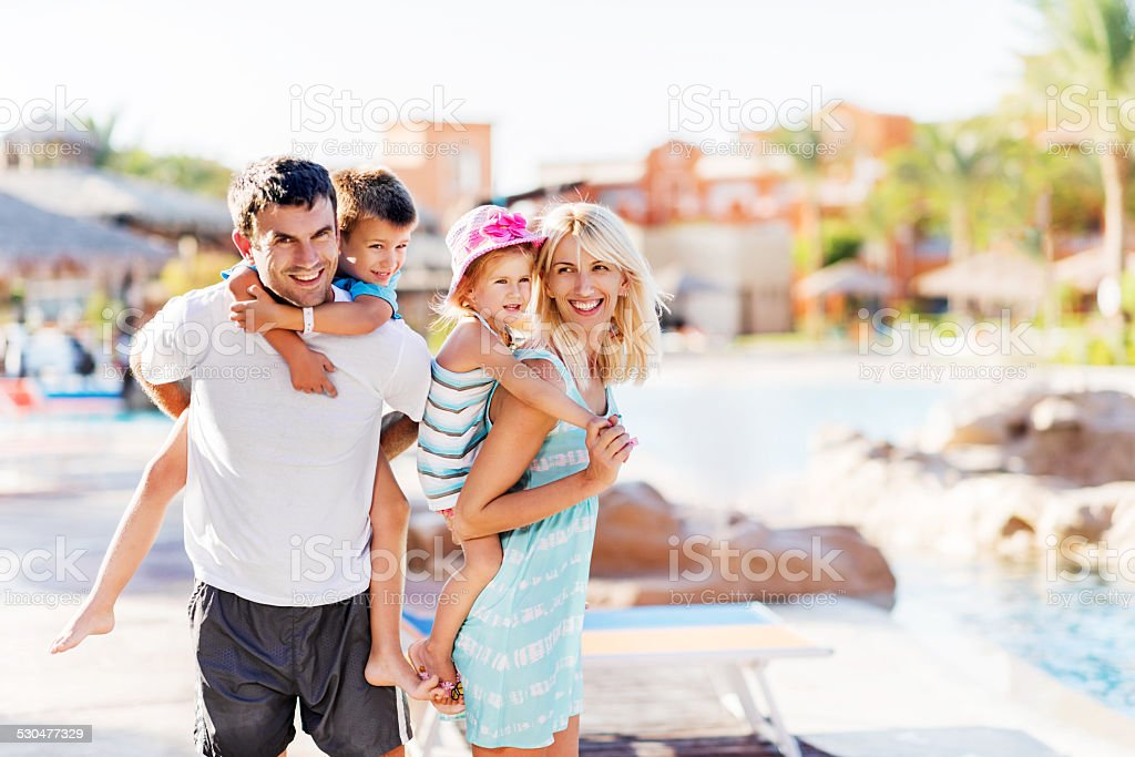 Playful family at tourist resort. stock photo