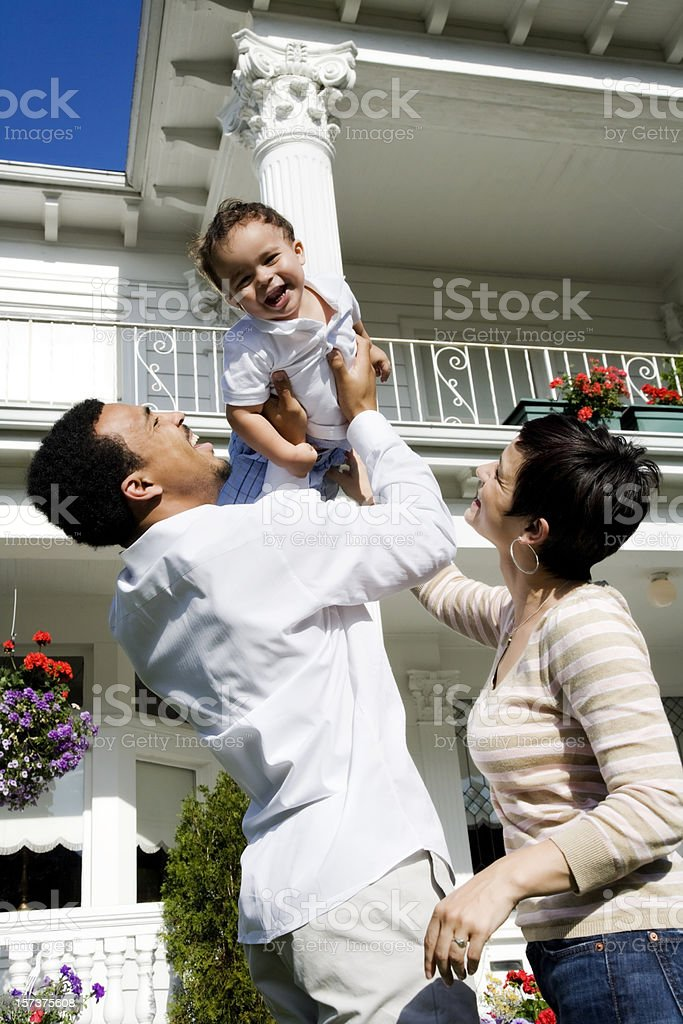 Playful Family of Three at Home royalty-free stock photo