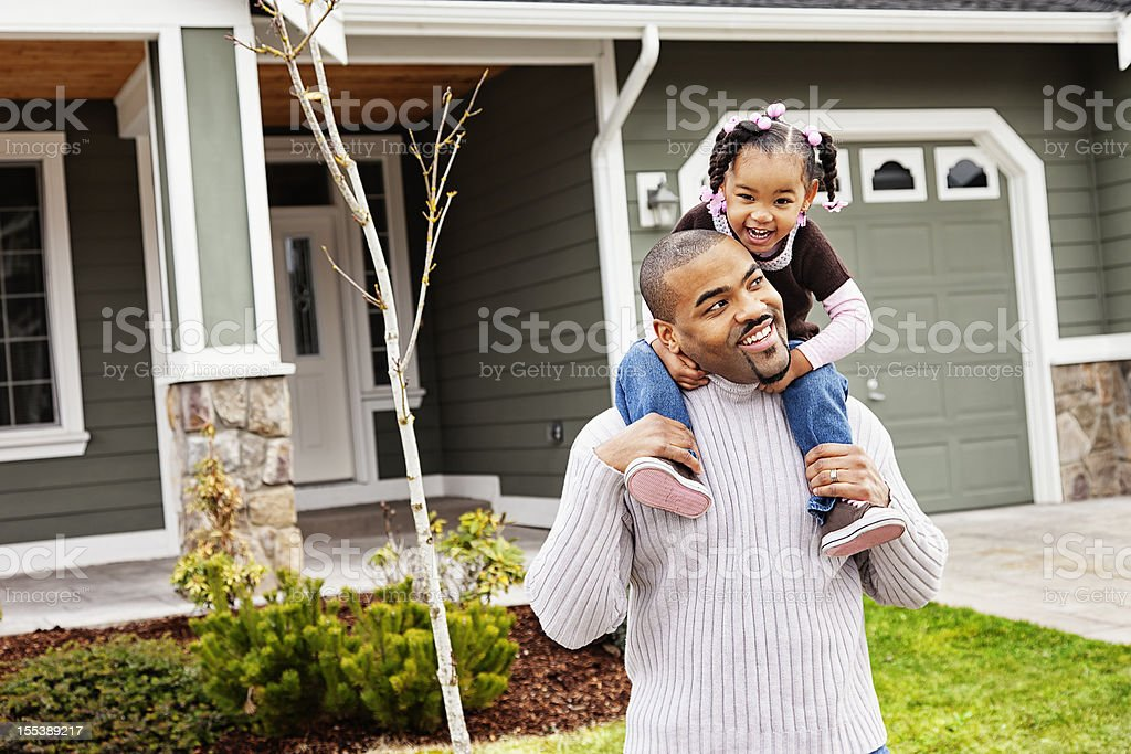 Playful Father and Daughter at Home stock photo